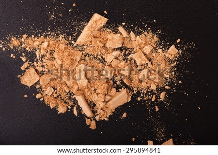 Background with colorful powder. Crushed eyeshadow on black background. Abstract  background  - stock photo
