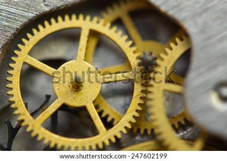 Background with golden metal cogwheels inside clockwork. Conceptual photo for your successful business design. Macro - stock photo