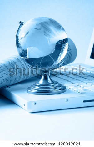 Background with laptop and blue globe - stock photo