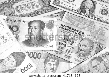 Background with many currency,money from many country black and white - stock photo