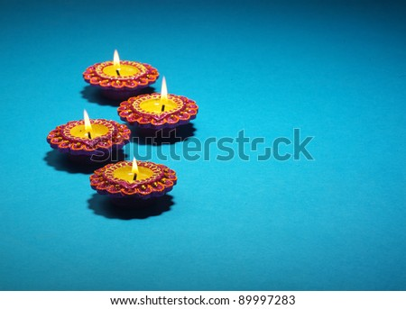 background with set of colorful  decorated diya for indian festival deepawali - stock photo