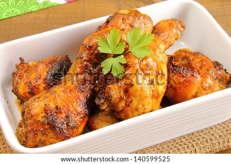 Baked chicken thighs - stock photo