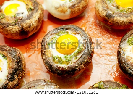Baked mushrooms with quail`s eggs