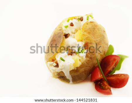Baked potato isolated on white with copy space. - stock photo