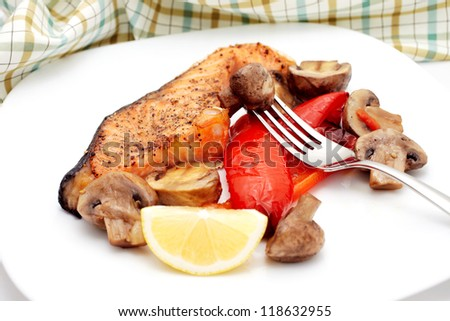 Baked salmon and vegetables - stock photo