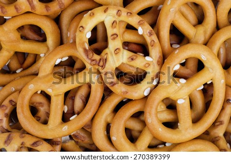 Baked salted wheat pretzels with sesame seeds. - stock photo