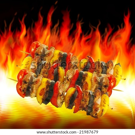 baking of barbecues on background of flames - stock photo