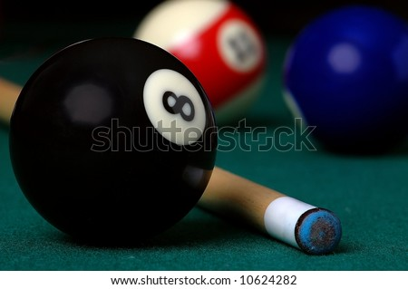 8 ball and a Pool Cue - stock photo