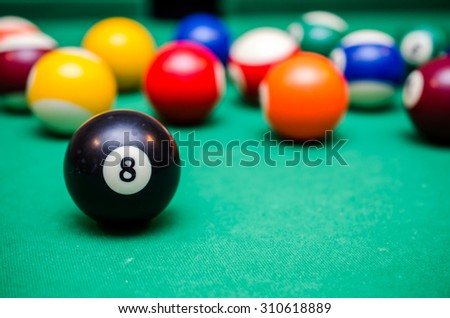 8 Ball from pool or billiards on a billiard table - stock photo