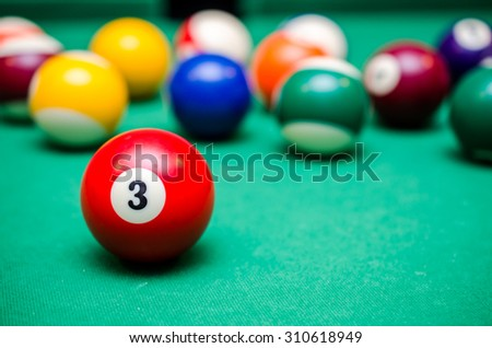 3 Ball from pool or billiards on a billiard table