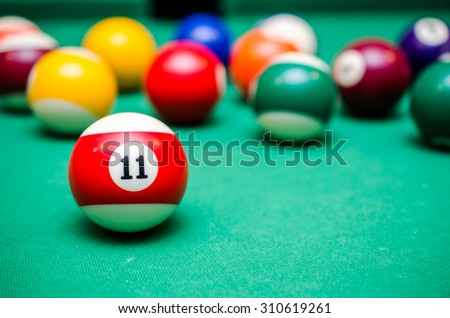 11 Ball from pool or billiards on a billiard table - stock photo