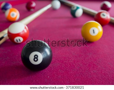 8 Ball from pool or billiards on a billiard table. Selective Focus. Billiard balls on the table - stock photo