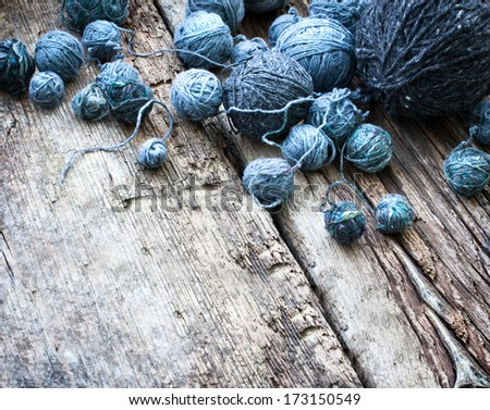 Balls of yarn on wooden background/ natural wool knitting background - stock photo