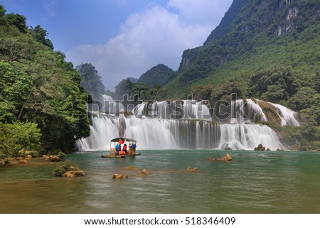 Ban Gioc waterfall, Cao Bang province, Vietnam - September 23, 2016 : tourists on boat at Ban Gioc waterfall in Cao Bang, Viet Nam. These are one of the nicest waterfalls in northern Vietnam.