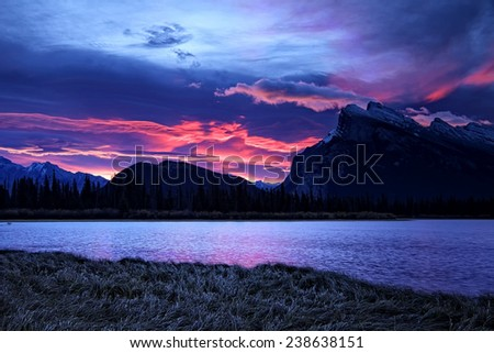 """""""Banff Sunrise""""  A dramatic October sunrise behind Mount Rundle (9,672') as captured from the Vermilion Lakes just outside Banff Alberta. - stock photo"""