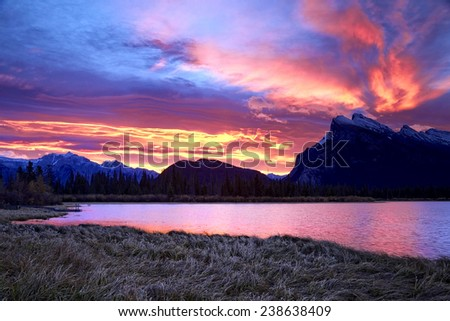 """""""Banff Sunrises Six Minutes Later"""" Second capture of a colorful October sunrise behind Mount Rundle as captured from the Vermilion Lakes just outside Banff. The Fairholme Range is in view on the left. - stock photo"""
