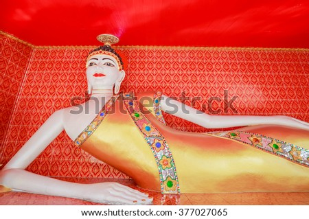 "BANGKOK - FEB,15 :The Reclining Buddha statue in the red hall temple named ""Wat Kun Chan"" where have statue of celestial monster which causes elipses by eating the sun or moon .THAILAND FEB,15 2016 - stock photo"