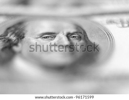 $100 banknote background with extremely shallow depth of field. Focus on eyes. - stock photo