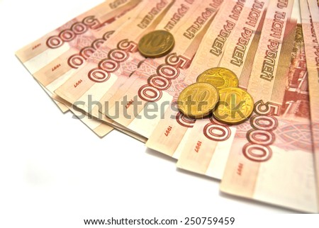 5000 banknotes and 10 rubles coins on white