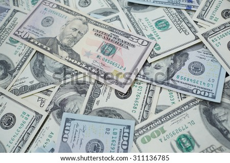 banknotes to 100 and 50 dollars  in a chaotic manner