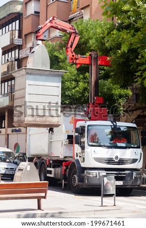 BARCELONA, SPAIN - JUNE 23: Garbage truck collects garbage cans in June 23, 2013 in Barcelona, Spain - stock photo