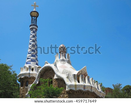 05.07.2016, Barcelona, Spain: The entrance of Park Guell with the famous mosaics of Antonio Gaudi over blue sky background. - stock photo