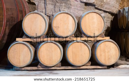 barrels in rows at contemporary winemaker factory  - stock photo