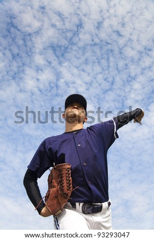 baseball pitcher with cloud background - stock photo
