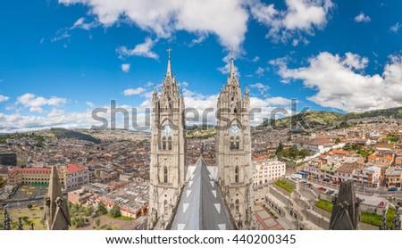 Basilica del Voto Nacional and doqntown Quito in  Ecuador - stock photo