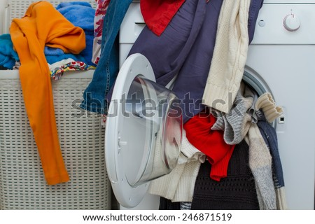 basket and wash machine of dirty laundry - stock photo