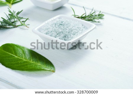 bath salt and cream on white wooden table background