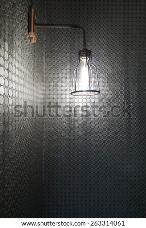 bathroom with mosaic tiles and wall lamp - stock photo