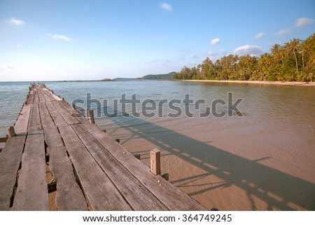 beach and wooden pier