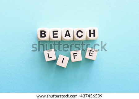 """BEACH BUM"" printed on white dice against an ombre blue background"