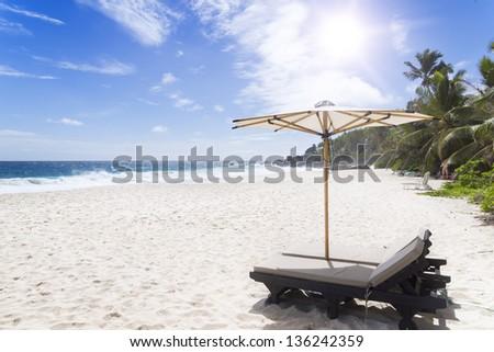 Beach chair at sunny coast. Seychelles. Mahe island. - stock photo