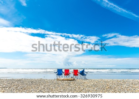 4 beach chair  lined in front of the sea,scenic view in Ruby beach on summer.Washington,Usa.