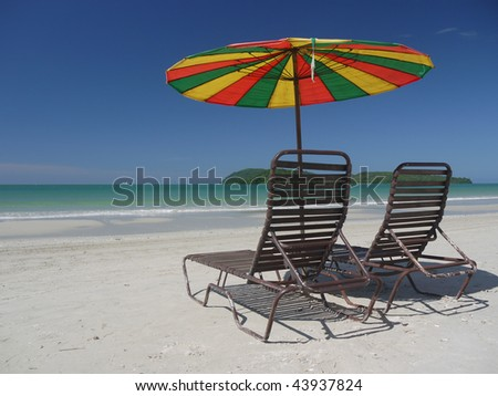 2 beach chairs at a beach on Langkawi island, Malaysia - stock photo