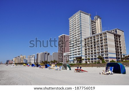 beach scene with condos and hotels - stock photo