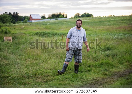 Bearded farmer on the field - stock photo