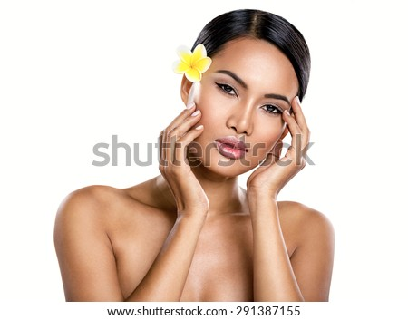 Beautiful Balinese woman with perfect skin, isolated over white  - stock photo