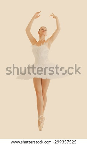 beautiful ballerina in classical tutu and pointe isolated and retro toning - stock photo