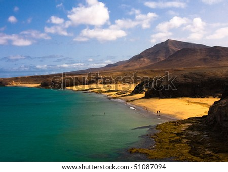 Beautiful beach and sea in Lanzarote island Spain ,whith mountains as background - stock photo