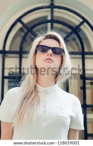 Beautiful blonde in sunglasses - stock photo
