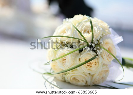 beautiful bouquet of the bride executed from light beige roses - stock photo