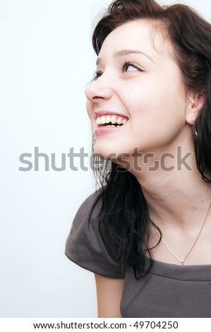 Beautiful Brunette Girl looking upside - stock photo