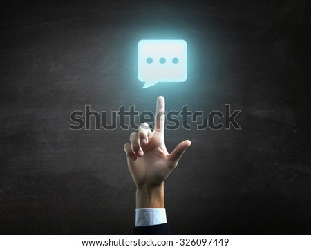 beautiful Business male hand indicating chat icon. - stock photo