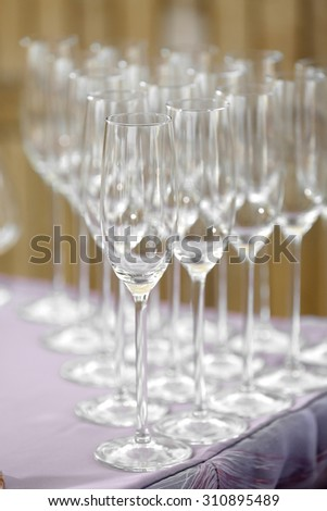 Beautiful champagne glasses defocused on buffet table in restaurant and blurred background