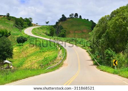 beautiful country roads in mountain - stock photo
