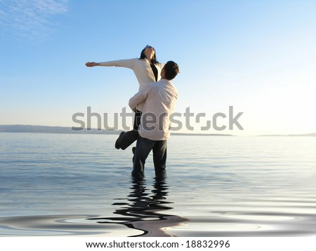 Beautiful day at the beach .......young couple are so happy... - stock photo