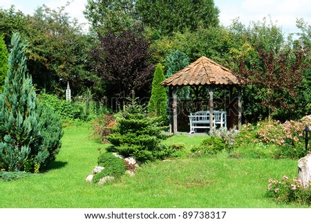 Beautiful decorative home garden yard gazebo pavilion in the summer